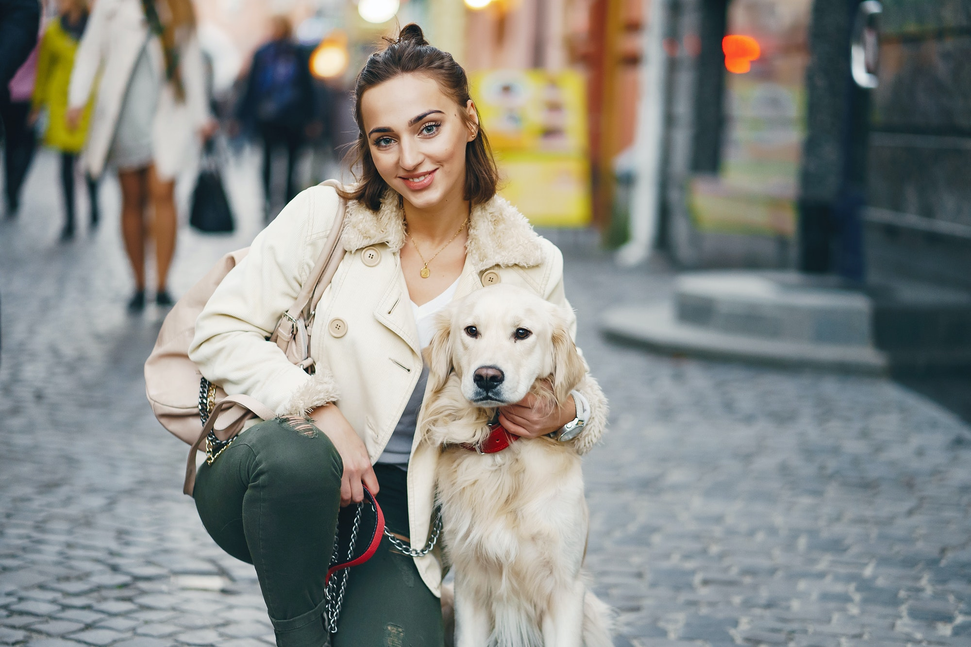 girl walking dog in the city
